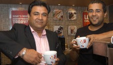 Novelist Chetan Bhagat (R) at launch of a new CCD outlet in B'lore